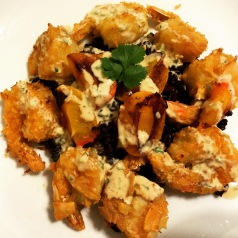Coconut shrimp with grilled apricots and peanut coconut jalapeno drizzle