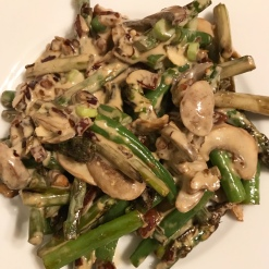 Mushrooms and asparagus tossed in Insane Sauce